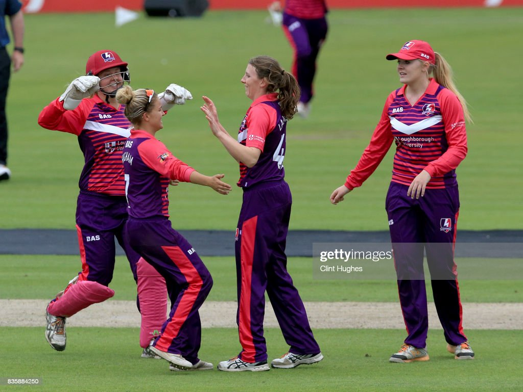 Beth Langston (C) of Loughborough Lightning celebrates after she takes the wicket of Natasha Miles of Lancashire Thunder during the Kia Super League match between Lancashire Thunder and Loughborough Lightning at Blackpool Cricket Club on August 20, 2017 in Blackpool, England.