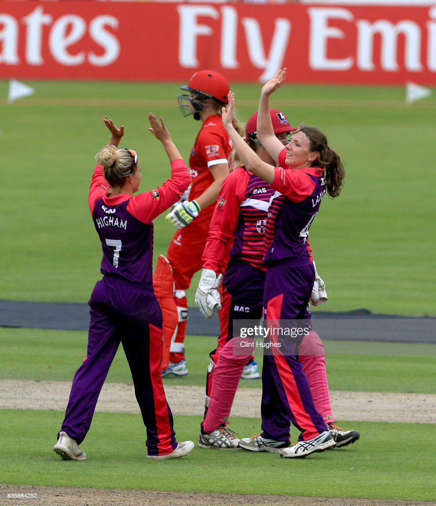 Beth Langston (R) of Loughborough Lightning celebrates after she takes the wicket of Ellie Threlkeld of Lancashire Thunder during the Kia Super League match between Lancashire Thunder and Loughborough Lightning at Blackpool Cricket Club on August 20, 2017 in Blackpool, England.