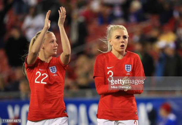 Beth Mead and Alex Greenwood of England celebrate victory after the 2019 SheBelieves Cup match between England and Japan at Raymond James Stadium on...