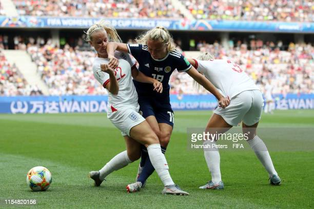 Beth Mead and Alex Greenwood of England put pressure on Claire Emslie of Scotland during the 2019 FIFA Women's World Cup France group D match between...
