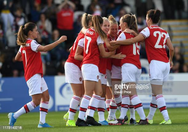 Beth Mead celebrates scoring Arsenal's 1st goal with her team mates during the WSL match between Arsenal Women and West HamUnited Women at Meadow...