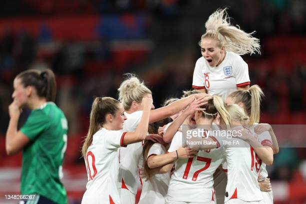 Beth Mead celebrates with teammates Ella Toone, Alex Greenwood and Bethany England of England after scoring their team's first goal during the FIFA...