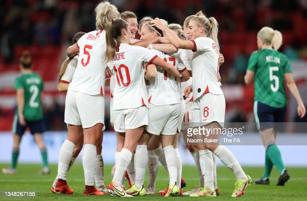 Beth Mead celebrates with teammates Millie Bright, Ella Toone, Lauren Hemp and Alex Greenwood of England after scoring their team's first goal during...