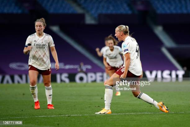 Beth Mead of Arsenal celebrates after scoring her team's first goal during the UEFA Women's Champions League Quarter Final between Arsenal FC Women...