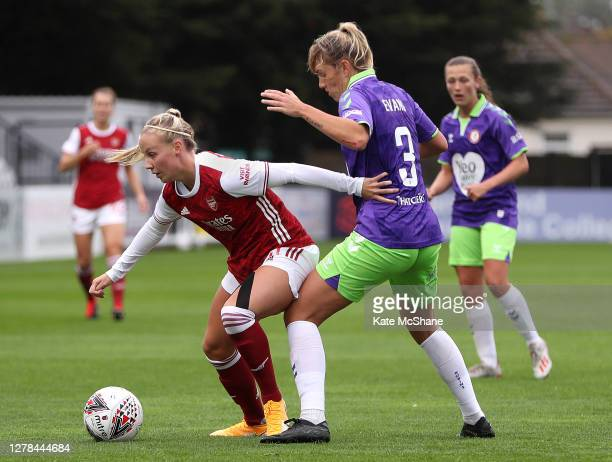 Beth Mead of Arsenal FC and Gemma Evans of Bristol City battle for possession during the Barclays FA Women's Super League match between Arsenal and...