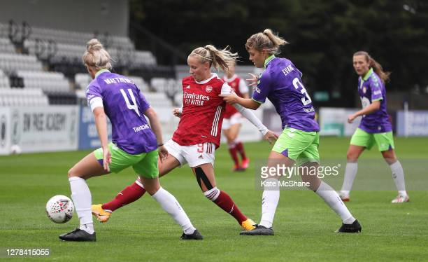Beth Mead of Arsenal FC controls the ball as Jas Matthews of Bristol City and Gemma Evans of Bristol City looks on during the Barclays FA Women's...