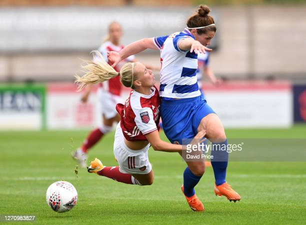 Beth Mead of Arsenal is challenged by Emma Mitchell of Reading during the match between Arsenal Women and Reading Women at Meadow Park on September...