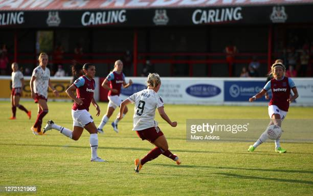 Beth Mead of Arsenal scores her team's fourth goal during the FA Women's Super League match between West Ham United and Arsenal FC at Chigwell...