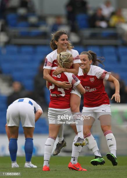 Beth Mead of Arsenal Women celebrates scoring the third goal with her team mates during the WSL match between Brighton and Hove Albion Women and...