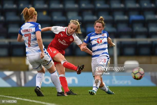 Beth Mead of Arsenal Women shoots under pressure from Rachel Furness and Rachel Rowe of Reading during the match between Reading FC Women and Arsenal...