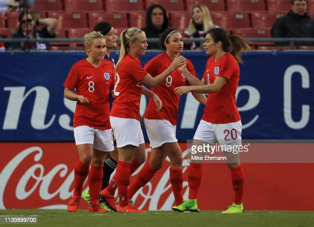 Beth Mead of England celebrates with Karen Carney and team mates after scoring her team's third goal during the 2019 SheBelieves Cup match between...