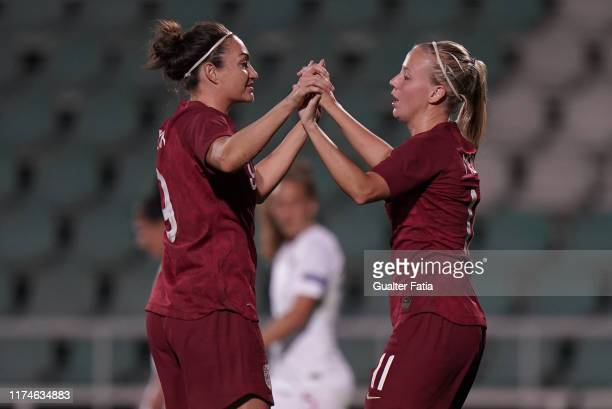 Beth Mead of England celebrates with teammate Jodie Taylor of England after scoring a goal during the International Friendly match between Portugal...