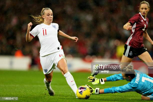 Beth Mead of England is taken down in the penalty area by Merle Frohms of Germany to win a penalty during the International Friendly between England...