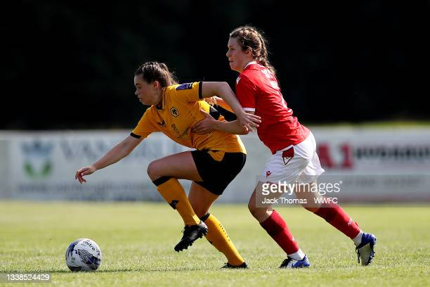Beth Merrick of Wolverhampton Wanderers is challenged by Rachel Brown of Nottingham Forest Women during the FAWNL Northern Premier Division match...