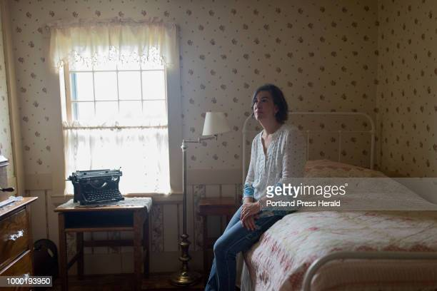 Beth Miller poses for a portrait in a bedroom at her home in the Paris Hill Historic District For almost a century the home belonged to the Parris...