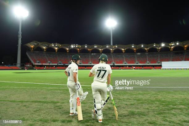 Beth Mooney and Alyssa Healy of Australia wait to take to the field during day four of the Women's International Test Match between Australia and...