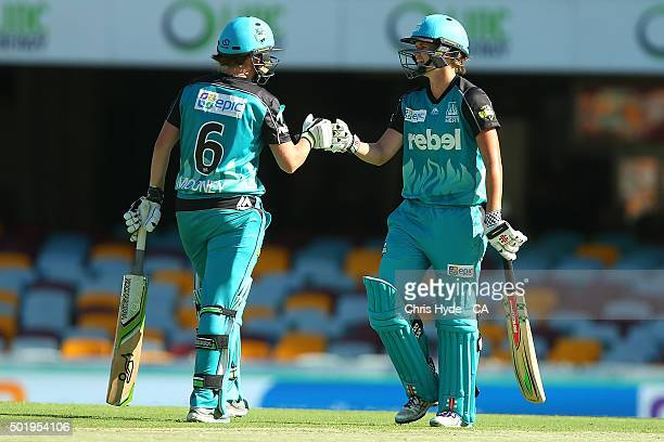 Beth Mooney and Jess Jonassen of the Heat celebrate a boundary during the Women's Big Bash League match between the Brisbane Heat and the Adelaide...