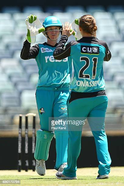Beth Mooney and Jess Jonassen of the Heat celebrate the wicket of Chloe Piparo of the Scorchers during the WBBL match between the Scorchers and Heat...