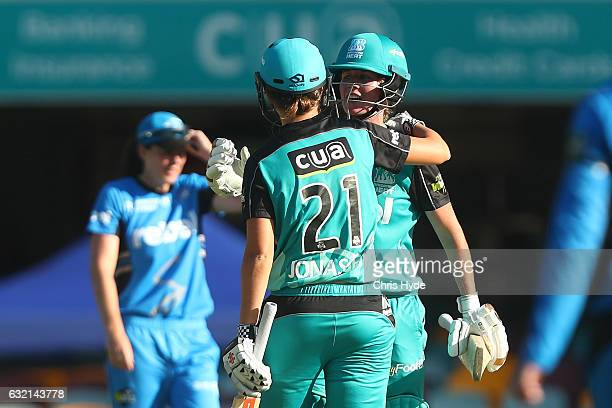 Beth Mooney and Jessica Jonassen of the Heat celebrate winning the Women's Big Bash League match between the Brisbane Heat and the Adelaide Strikers...