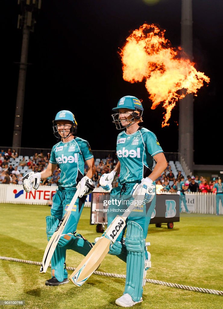 Beth Mooney and Kirby Short of the Heat walk out to bat at the start of the Heat innings during the the Women's Big Bash League match between the Brisbane Heat and the Melbourne Stars at Harrup Park on January 12, 2018 in Mackay, Australia.
