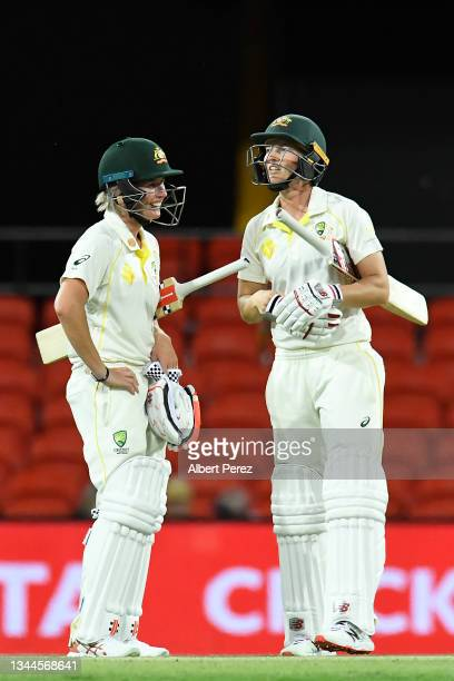 Beth Mooney and Meg Lanning of Australia speak during day four of the Women's International Test Match between Australia and India at Metricon...