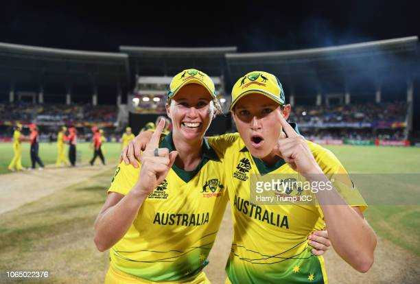 Beth Mooney and Megan Schutt of Australia celebrate during the ICC Women's World T20 2018 Final between Australia and England at Sir Vivian Richards...