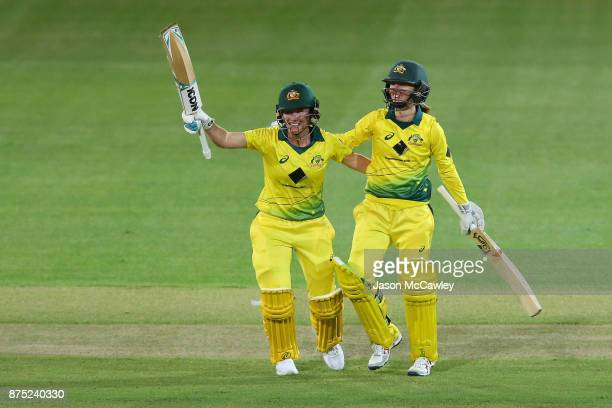 Beth Mooney and Rachael Haynes of Australia celebrate winning during the first Women's Twenty20 match between Australia and England at North Sydney...