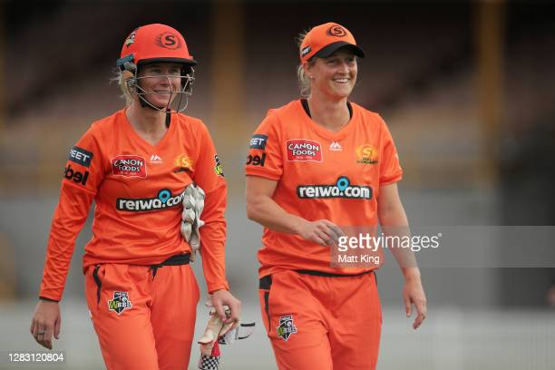 Beth Mooney and Sophie Devine of the Scorchers walk off after fielding during the Women's Big Bash League WBBL match between the Melbourne Renegades...