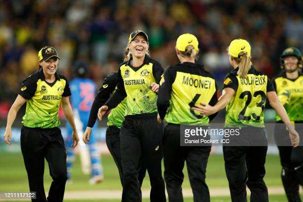 Beth Mooney of Australia celebrates after catching out Radha Yadav of India during the ICC Women's T20 Cricket World Cup Final match between India...