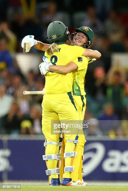 Beth Mooney of Australia celebrates scoring a century during the Third Women's Twenty20 match between Australia and England at Manuka Oval on...