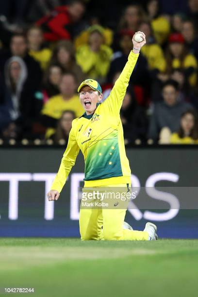 Beth Mooney of Australia celebrates taking the catch to dismiss Sophie Devine of New Zealand during game one of the International Twenty20 series...
