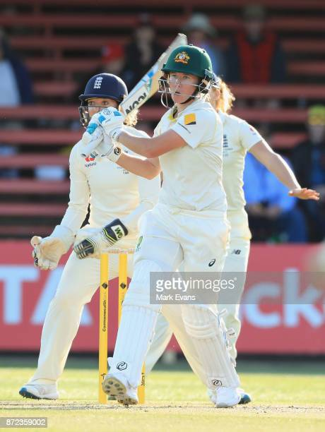 Beth Mooney of Australia hits to deep mid wicket and is caught by Natalie Sciver off the bowling of Sophie Ecclestone during day two of the Women's...