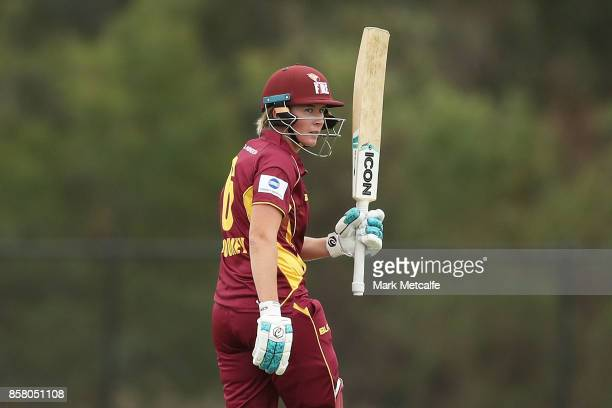 Beth Mooney of Queensland celebrates and acknowledges the crowd after scoring a half century during the WNCL match between New South Wales and...