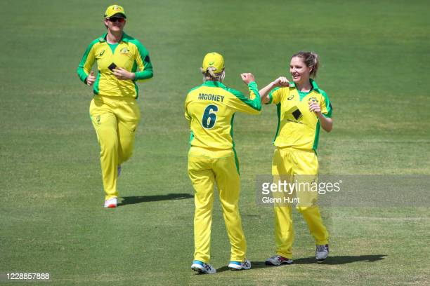 Beth Mooney of the Australia celebrates getting the wicket of Rosemary Mair of New Zealand during game one in the women's One Day International...