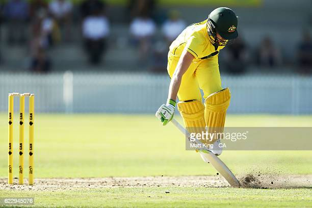 Beth Mooney of the Governor General's XI slides in to avoid a runout during the women's tour match between the Governer General's XI and South Africa...