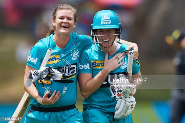 Beth Mooney of the Heat and Jessica Jonassen of the Heat celebrate victory during the Women's Big Bash League match between the Perth Scorchers and...