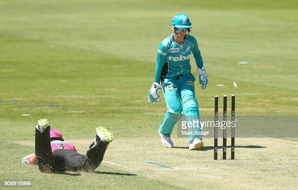 Beth Mooney of the Heat attempts a run out during the Women's Big Bash League match between the Brisbane Heat and the Sydney Sixers at Hurstville...