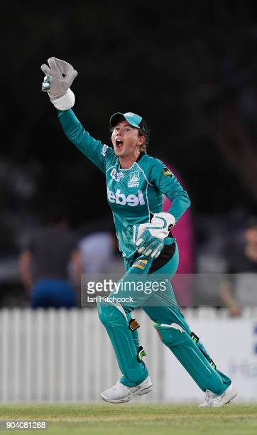 Beth Mooney of the Heat celebrates after taking the catch to dismiss Lizelle Lee of the Stars during the the Women's Big Bash League match between...