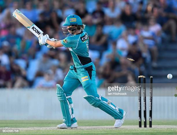 Beth Mooney of the Heat is bowled during the Women's Big Bash League match between the Brisbane Heat and the Melbourne Stars on January 13 2018 in...