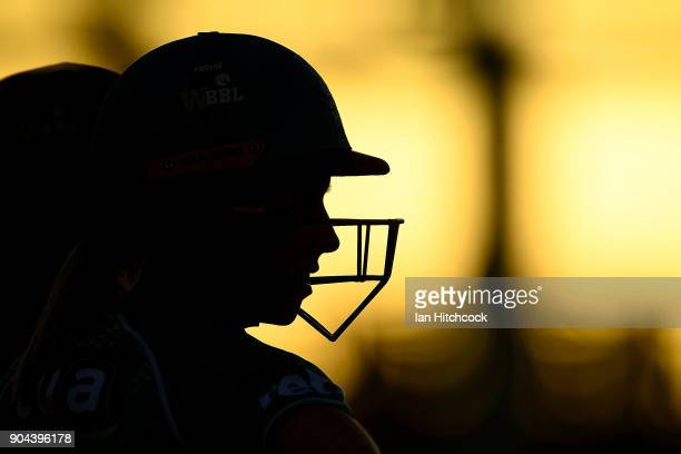 Beth Mooney of the Heat prepares to walk onto the field before the start of the Women's Big Bash League match between the Brisbane Heat and the...