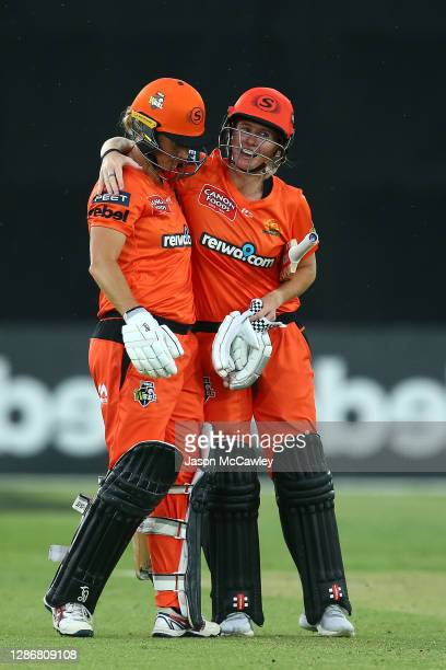 Beth Mooney of the Scorchers and Sophie Devine of the Scorchers celebrate victory during the Women's Big Bash League WBBL match between the Hobart...