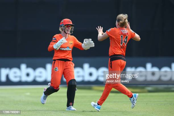 Beth Mooney of the Scorchers celebrate with Samantha Betts of the Scorchers after taking the wicket of Nicola Carey of the Hurricanesduring the...