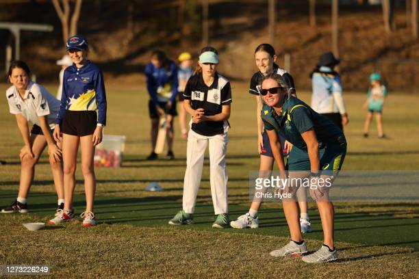 Beth Mooney plays cricket with the Holland Park Junior Cricket Club during the Cricket Australia Women's World Cup Trophy tour at Holland Park Junior...