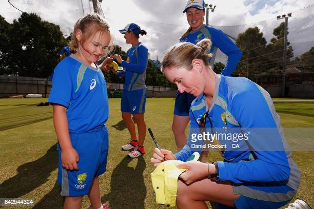 Beth Mooney signs autographs for fans during a Southern Stars training session at Melbourne Cricket Ground on February 18 2017 in Melbourne Australia