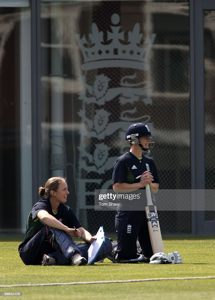 Beth Morgan and Claire Taylor of England look on from the boundry during the England Women's Cricket Team training session at the ECB Academy on April 23, 2010 in Loughborough, England.
