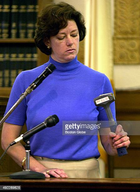 Beth Murphy an employee at F Diehl's Son Hardware in Wellesley holds the hammer during the trial of Dr Dirk Greineder at Norfolk Superior Court in...
