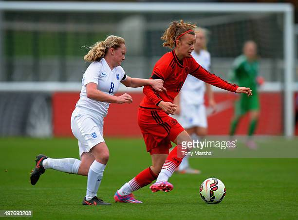 Beth O'Donnell of England tackles Lena Lattwein of Germany during Women's U16s International Friendly match between England U16s Women and Germany...
