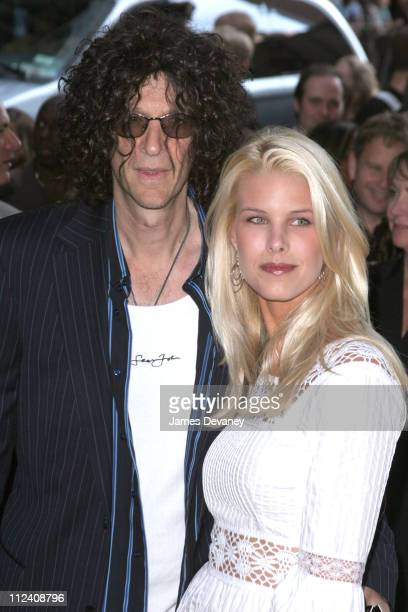 Beth Ostrosky and Howard Stern during War of the Worlds New York City Premiere Outside Arrivals at Ziegfeld Theatre in New York City New York United...