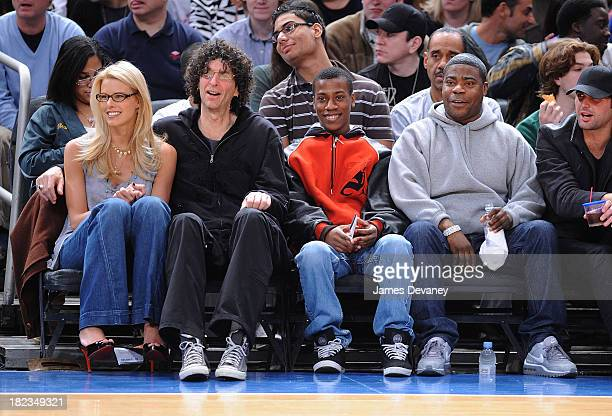 Beth Ostrosky, Howard Stern, Tracy Morgan and guest attend Charlotte Bobcats vs New York Knicks game at Madison Square Garden on March 7, 2009 in New...