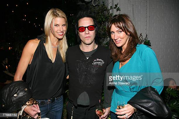 Beth Ostrosky Michael Hilfiger and Melissa Zapin pose for photos at the after party to the Citi sponsored Duran Duran Red Carpet Massacre on Broadway...